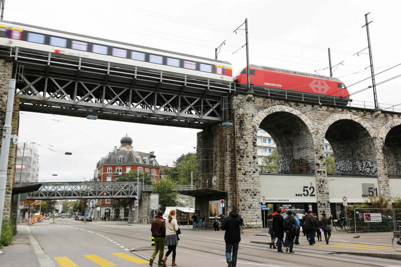 Im Viadukt Shopping Mile with SBB Train Crossing in Zürich, Switzerland