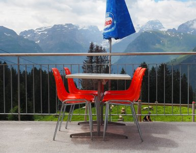 Swiss Restaurant with Orange Chairs