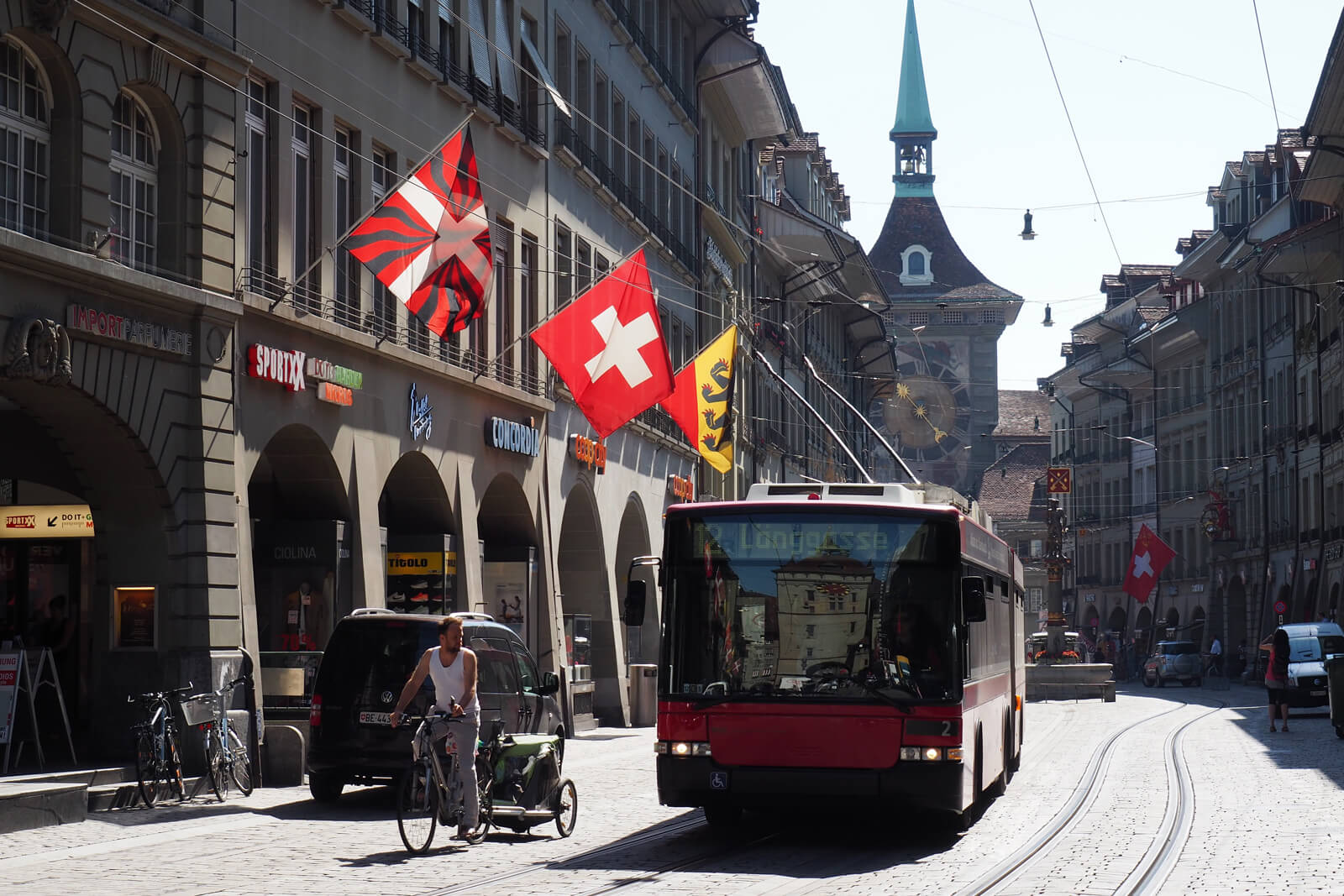 A Swiss flag waving in the Old Town of Bern, Switzerland