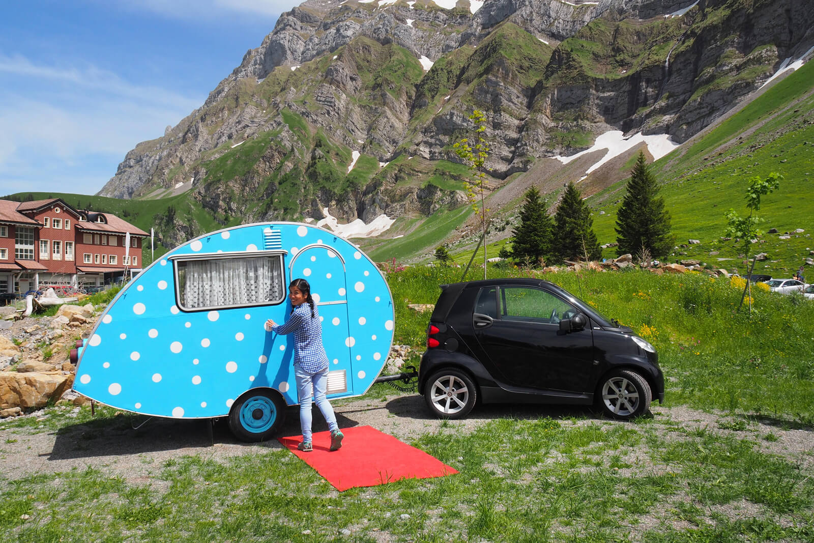 Smart car with tiny vintage trailer in Switzerland