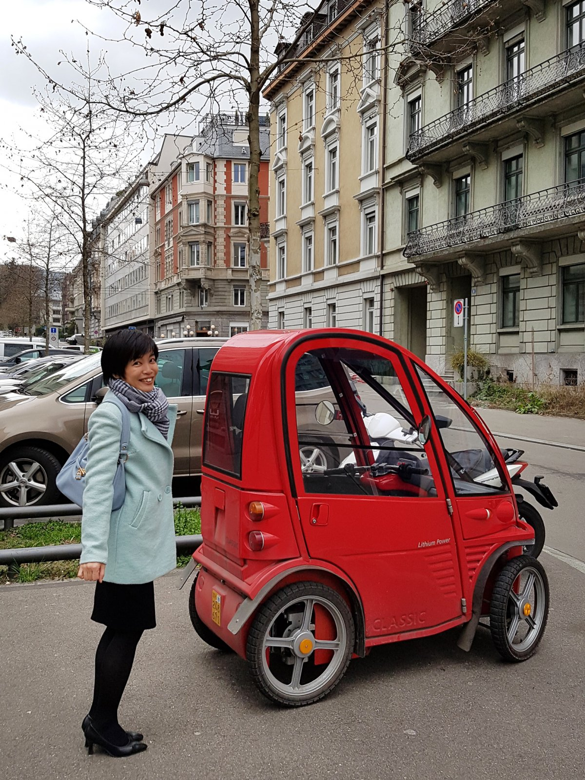 A tiny car parked in Switzerland