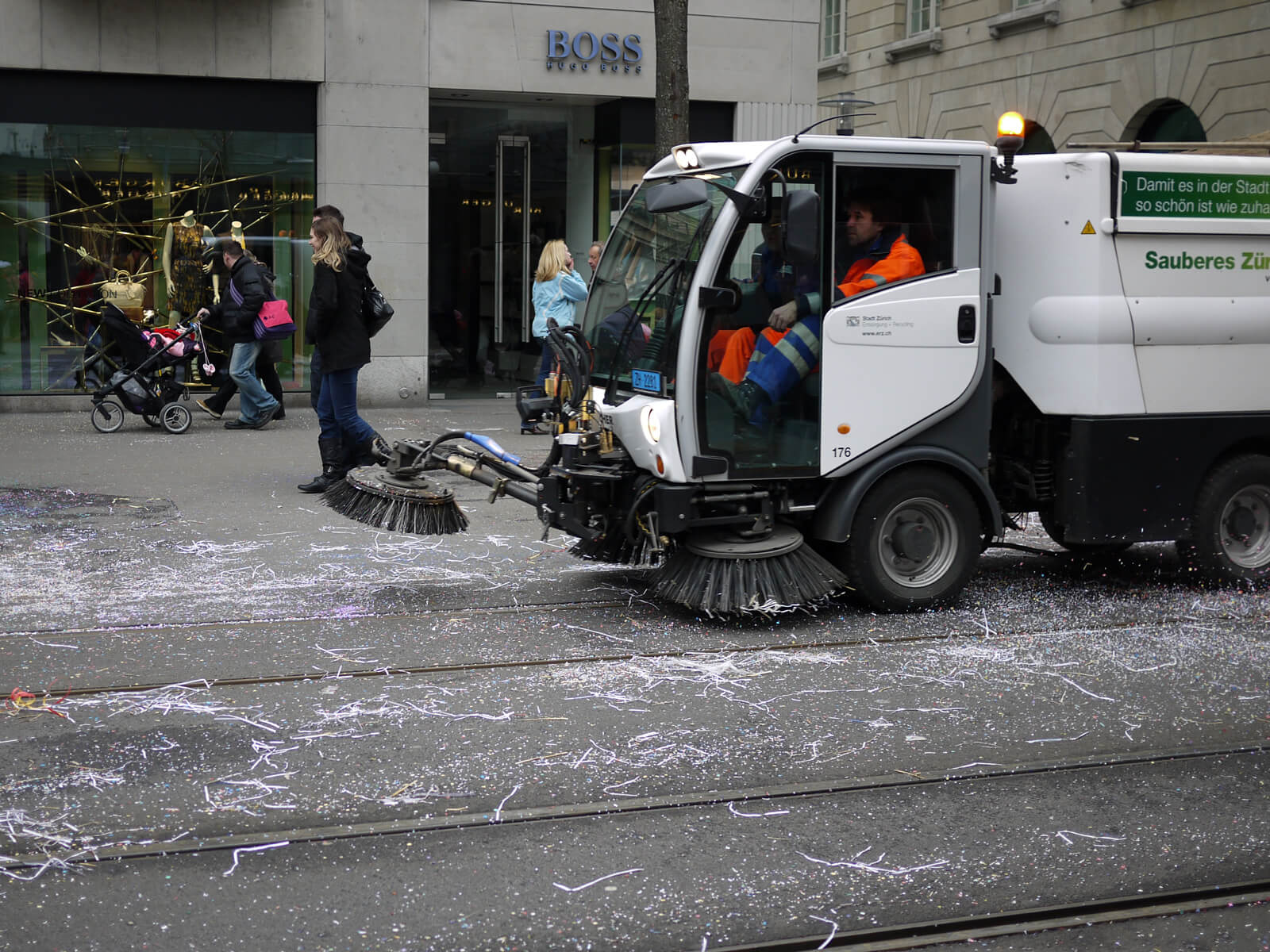 Cleaning crew on Bahnhofstrasse after the Zürich Carnival parade