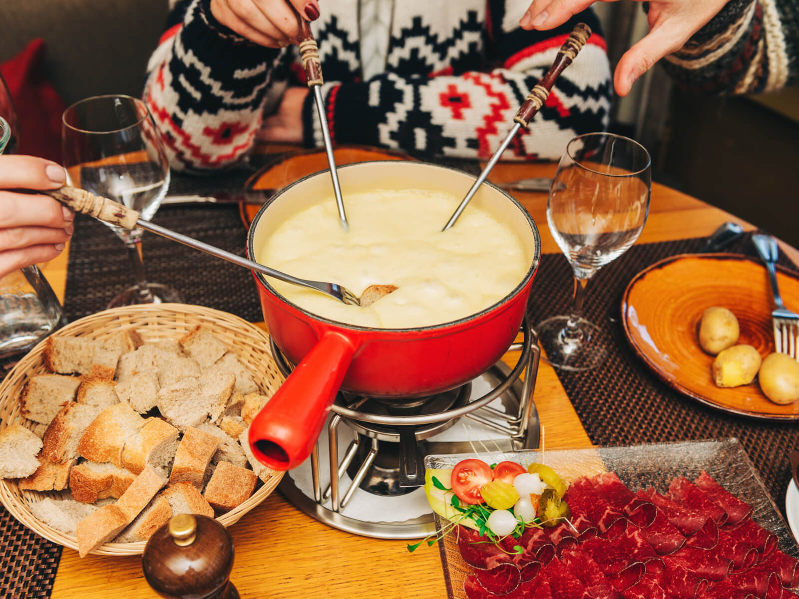Cheese in Switzerland - A typical Swiss cheese fondue party